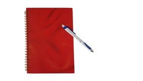Блокнот с изолятом ручки стоковое фото rf