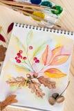 Блокнот с листьями осени картин акварели Стоковое фото RF