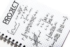 Блокнот с математически проектом Стоковое фото RF