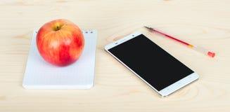 Блокнот телефон и яблоко стоковые фотографии rf