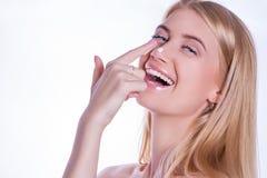 Блондинка с сливк на ее носе Стоковые Фотографии RF