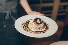 Блюда в руке стоковые фото