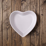 Блюдо белого сердца форменное Стоковые Фотографии RF