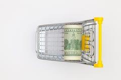 Вагонетка покупок и 100 долларов банкноты Стоковая Фотография