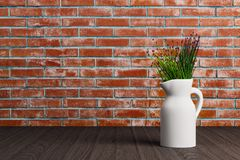 Ваза с цветками на предпосылке кирпича иллюстрация штока