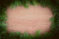 Вал ели рождества на деревянной доске Стоковые Фото