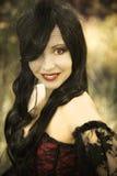 Вампир девушки в винтажном платье Стоковые Изображения