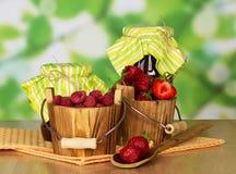 Варенье, ведра с поленикой и клубника Стоковая Фотография