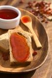 Варенье розового бедра на хлебе Стоковые Изображения