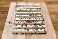 Вафли печенья в поливе на деревянном столе стоковые изображения rf