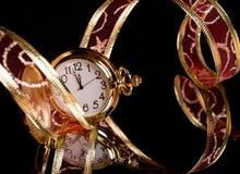 Вахта золота и красная чувствительная тесемка на черноте Стоковая Фотография RF