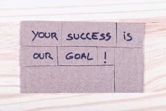 Ваш успех наша цель! написанный с черной ручкой войлок-подсказки в отрезке стоковое изображение