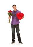 Валентинка: Розы и конфета для подарка дня валентинки Стоковые Фото