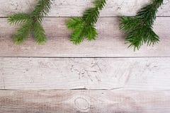 Вал ели рождества на деревянной доске Стоковая Фотография RF