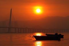 вдоль захода солнца Hong Kong свободного полета Стоковая Фотография