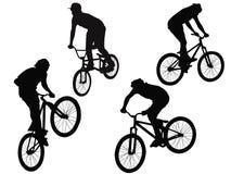 векторы силуэтов велосипедистов Стоковое фото RF