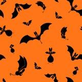 Вектор безшовный хеллоуин бить силуэт на оранжевой предпосылке Стоковая Фотография RF