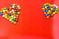 вектор красного цвета 2 иллюстрации сердец предпосылки сердца пестротканые помадка сердца Стоковые Фото