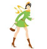 Вектор пальто зеленого цвета девушки шаржа Стоковая Фотография
