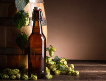 вектор померанца иллюстрации бутылки пива предпосылки Стоковая Фотография RF