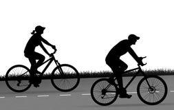 Вектор силуэта 2 велосипедистов Стоковая Фотография