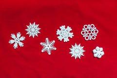вектор снежинок иллюстрации рождества предпосылки красный Привод игрушки рождества Стоковая Фотография
