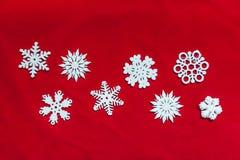 вектор снежинок иллюстрации рождества предпосылки красный Привод игрушки рождества Стоковое Изображение