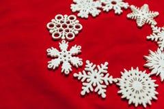 вектор снежинок иллюстрации рождества предпосылки красный Привод игрушки рождества Стоковое фото RF