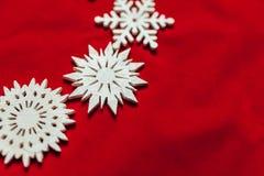 вектор снежинок иллюстрации рождества предпосылки красный Привод игрушки рождества Стоковые Фотографии RF