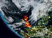 Великобритания на ноче от космоса Иллюстрация штока