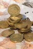 Великобританские монетки и примечания Стоковые Изображения