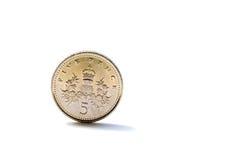 великобританские пенни монетки 5 определяют Стоковые Изображения RF