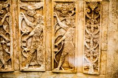 ВЕЛИКОБРИТАНСКИЙ МУЗЕЙ - задний люнет цвета слоновой кости от Nimrud, восьмой век ДО РОЖДЕСТВА ХРИСТОВА Стоковая Фотография