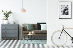 Велосипед положение в белом интерьере живущей комнаты открытого пространства с серым цветом Стоковое фото RF