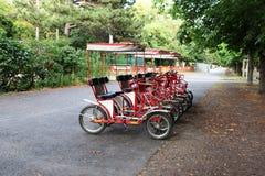 Вена, Австрия: Pedicabs в парке Prater Стоковые Фото