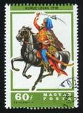 ВЕНГРИЯ - ОКОЛО 1978: Штемпель почтового сбора напечатанный в выставках Венгрии показывает Kuruc Lovas серия всадников спины лоша Стоковое Изображение