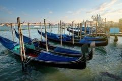 Венецианские гондолы на заходе солнца Стоковая Фотография