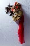 Венецианские маски на старой стене Стоковая Фотография