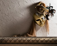 Венецианские маски на старой стене Стоковые Фото