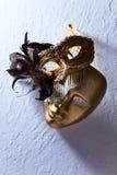 Венецианские маски на старой стене Стоковое фото RF