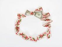 Венок ленты падуба с долларовой банкнотой Стоковая Фотография