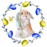 Венок пасхи цветков и хворостин с пасхальными яйцами и кроликом белизна изолированная предпосылкой Стоковое фото RF