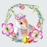 Венок пасхи цветков и хворостин с пасхальными яйцами и кроликом Изолировано на предпосылке Стоковые Изображения RF