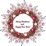 Венок рождества сделанный ветвей украшен с sprigs Стоковое Изображение
