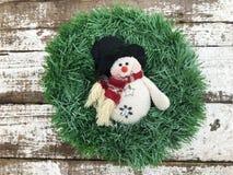 Венок рождества с снеговиком Стоковая Фотография