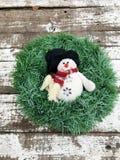 Венок рождества с снеговиком Стоковое Изображение