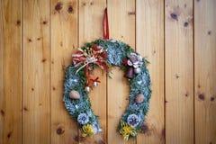 Венок рождества на дверях Стоковое Изображение