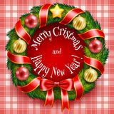 Венок рождества на красной предпосылке шотландки Стоковые Фото