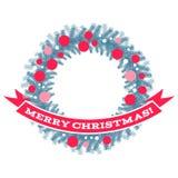 Венок рождества с лентой и приветствиями Стоковые Фото
