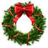 Венок рождества с красными смычком и лентой Стоковое Изображение RF